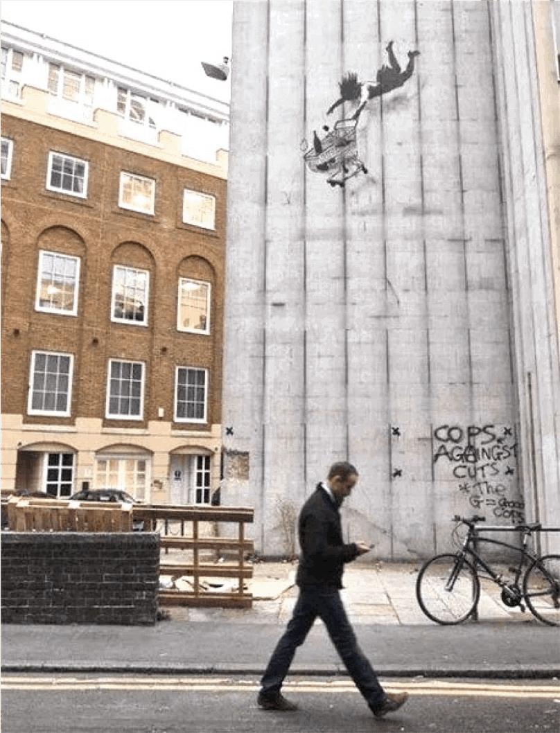 Falling Shopper (2011) by Banksy