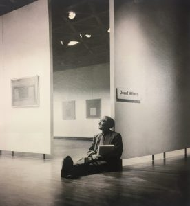 Albers on the floor of his exhibition in Yale, 1956